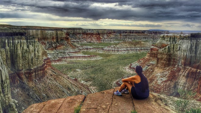 """""""Such a beautiful canyon on the Navajo Reservation called Coal Mine Canyon,"""" writes Rachelle Hardy of Tuba City. She paused for the view while friend Ryan Goldtooth snapped a photo. See more of her photos at instagram.com/made4_az."""