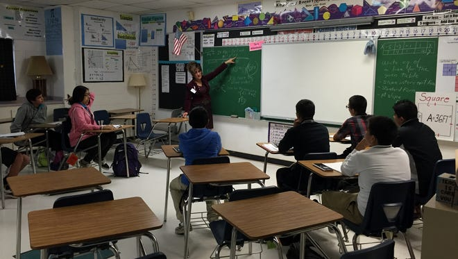 Camino Real Middle School eighth-graders listen to a lesson in an Algebra I class on Nov. 2.