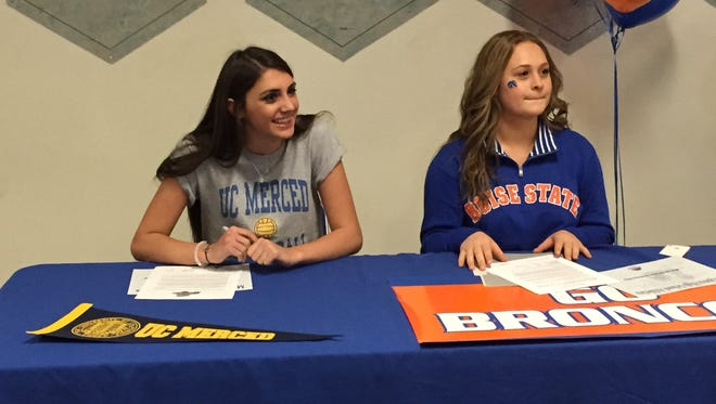 Hannah Spevak, left, and Casey McCord signed their Letters-of-Intent on Wednesday at McQueen