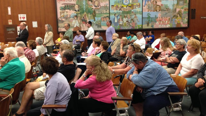 Residents of adult communities attended the Lakewood Township Committee meeting June 16, 2016 to protest the township's policy of providing free trash pickups for private schools, nonprofits and downtown businesses.