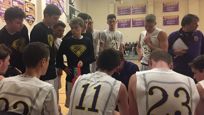 The Rhinebeck High School basketball team huddles during its game against Pine Plains.