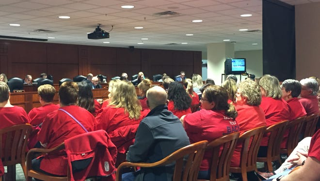 Dozens of people wearing red shirts signifying their support for nurses filled a hearing room at the Anderson House Officer Building in downtown Lansing on Wednesday, Nov. 29, 2017 as a legislative panel debated a trio of bills that would limit overtime and caseloads for nurses.