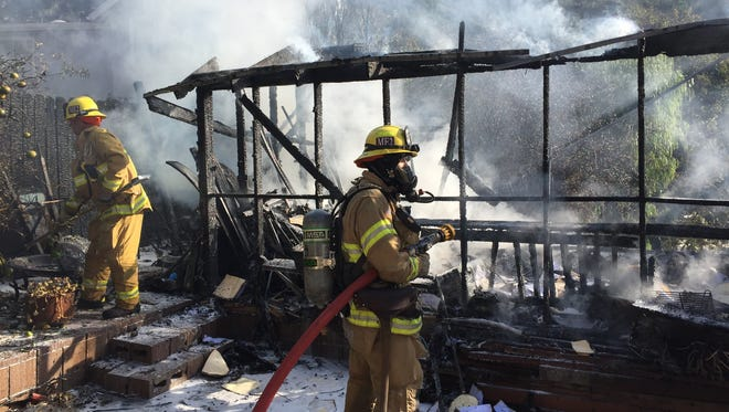 City of Ventura firefighters tackled a fire at a singe-family home in the Ventura hills Sunday morning.
