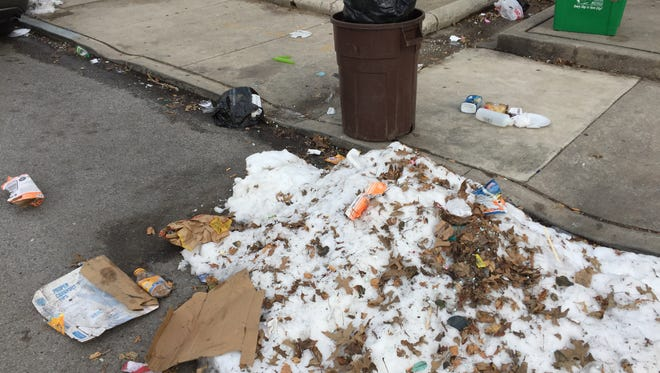 Trash on Jackson Street in York on March 25, 2018.
