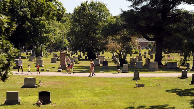 People walk, jog, and bike  through the Evergreen Cemetery in Medway, July 2, 2020.