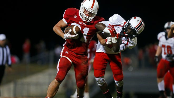 Colton Pomeroy (left) and the Reeds Spring Wolves host Aurora Friday in the Class 3 high school football playoffs.