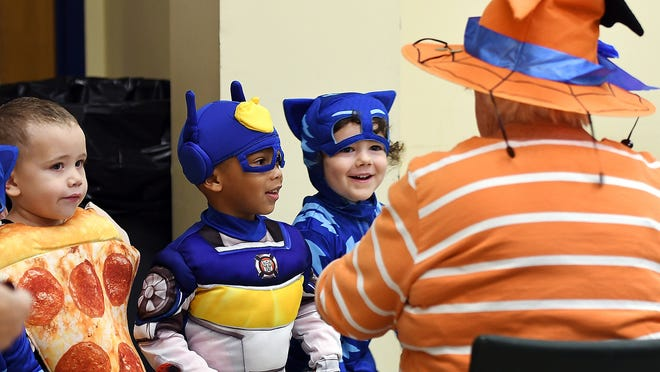 Youngsters trick-or-treat at the Worcester Senior Center last Halloween. This year, due to COVID-19, officials have banned door-to-door trick-or-treating in the city.