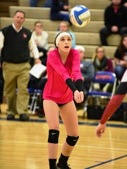 Churchill senior libero Alyssa Facione bumps the ball