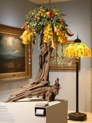 The Art in Bloom exhibit at the Milwaukee Art Museum has featured floral artists designing arrangements to complement specific works in the museum.
