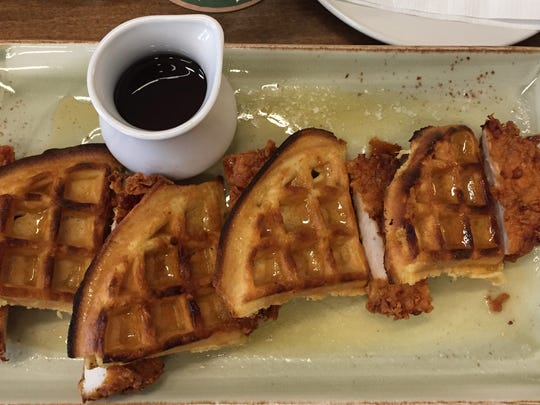 Chicken and waffles, $10, from Tin Roost in North Liberty are shown on Feb. 24, 2018.
