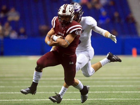 Calallen's Alec Brown runs past College Station players during the Class 5A Division II state semifinal Friday, Dec. 9, 2016, at the Alamodome in San Antonio.