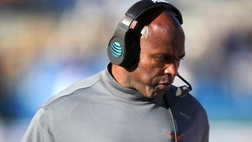 Coach Charlie Strong says he wants to stay at Texas