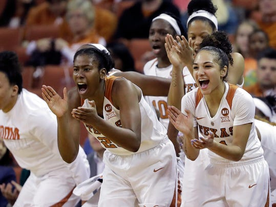 FILE - In this Feb. 10, 2018, file photo, Texas guard Brooke McCarty, right, guard Ariel Atkins, center, and teammates celebrate from the bench during the second half of an NCAA college basketball game against Kansas State, in Austin, Texas. McCarty and Atkins have gone deep into the NCAA women's tournament each year of their career. Just not far enough. The Texas seniors who have played a huge role in reviving a dormant powerhouse are seniors now with one last shot to do something special, starting Saturday, March 17, 2018 when the No. 2 seed Longhorns meet No. 15 Maine in the Austin region. (AP Photo/Eric Gay, File)