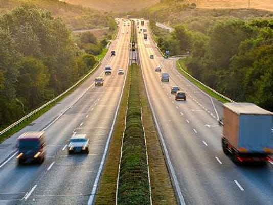 635766412190883391-various-vehicles-in-highway-traffic-573x300