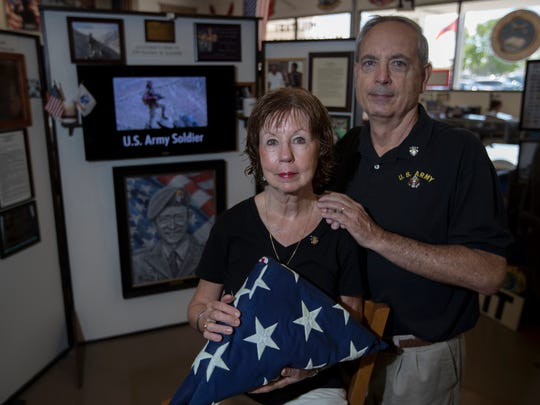 Cape Coral residents Bill and Margaret Eggers, are the parents of Daniel Eggers who was killed in action during a mine explosion in Afghanistan on May 29, 2004. They are in front of a memorial for Daniel which is in place at the Southwest Florida Military Museum & Library in downtown Cape Coral on Friday, May 18, 2018.