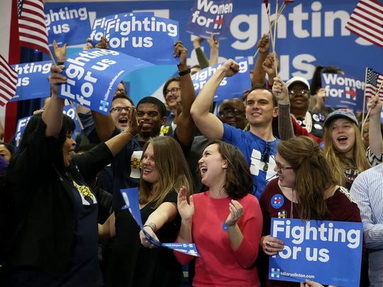 Supporters of Democratic presidential candidate Hillary Clinton celebrate during her primary night gathering at the University of South Carolina on February 27, 2016 in Columbia, South Carolina.