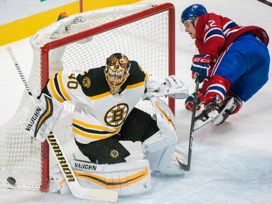 Boston Bruins goaltender Tuukka Rask makes a save against Montreal Canadiens' Byron Froese during the first period of an NHL hockey game, Saturday, Jan. 20, 2018 in Montreal. (Graham Hughes/The Canadian Press via AP)