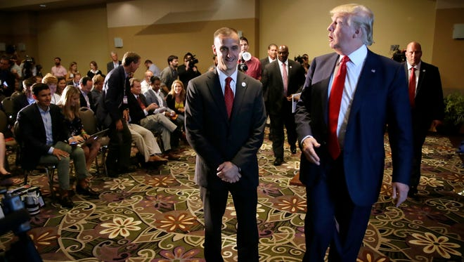 In this Aug. 25, 2015 file photo, Republican presidential candidate Donald Trump walks with his campaign manager Corey Lewandowski, left, after speaking at a news conference in Dubuque, Iowa. Trump says his decision to stand behind his campaign manager after he was charged with assaulting a female reporter is a sign of loyalty,  a trait that Trump has displayed, for better or worse, through much of his career.