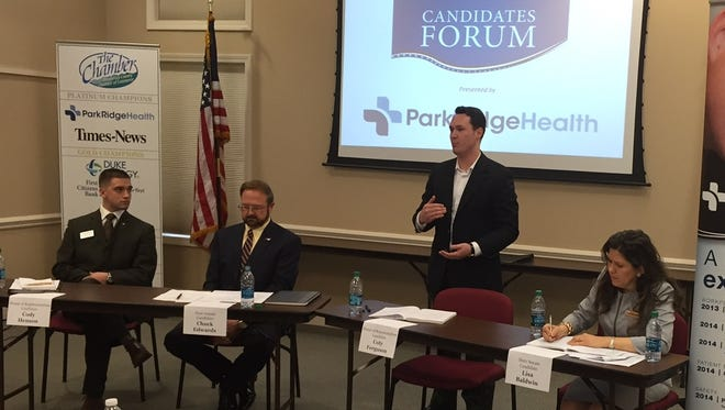 State House candidate Coty Ferguson speaks during a candidate forum Tuesday in Hendersonville. Also shown are, from the left, House candidate Cody Henson and Senate candidates Chuck Edwards and Lisa Baldwin