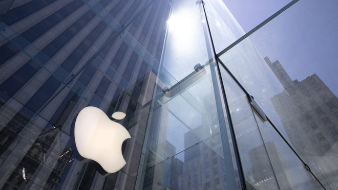 In this June 16  file photo, the sun is reflected on Apple's Fifth Avenue store in New York.