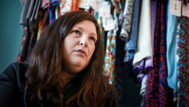 Pamela Winkelman, a former LuLaRoe Clothing Co. consultant, is involved in the class-action lawsuit against the company. She is shown Thursday, Nov. 9, with some of her remaining clothes.