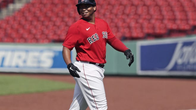 Boston's Rafael Devers heads to the dugout after hitting a double during an intrasquad game on Thursday.
