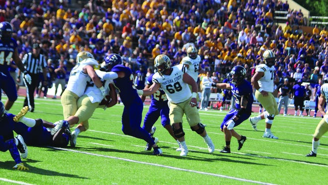 The Western Illinois defense makes a tackle during a game last fall.