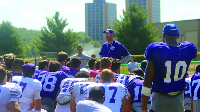 Western Illinois football coach Jared Elliott talks with his team during summer camp last August.