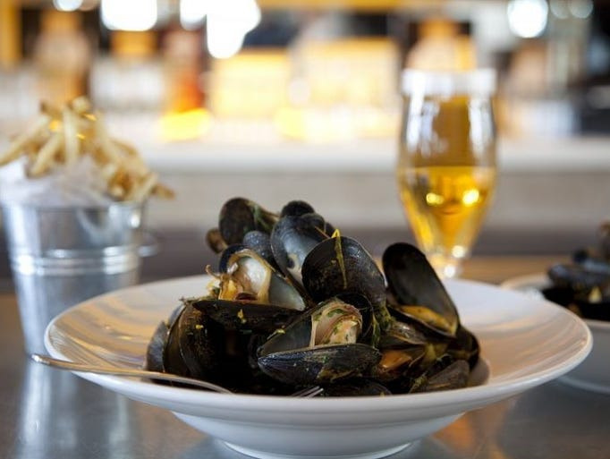 Littleneck clams are among the items on Avenue's happy-hour menu.