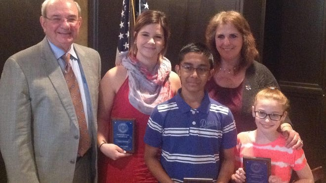 From left to right: Al Roberts, Rotarian; students Arianna Italiano and Tabshiruddin Forkan; Wendy McNamara, Rotarian and student Michelle Wagner.