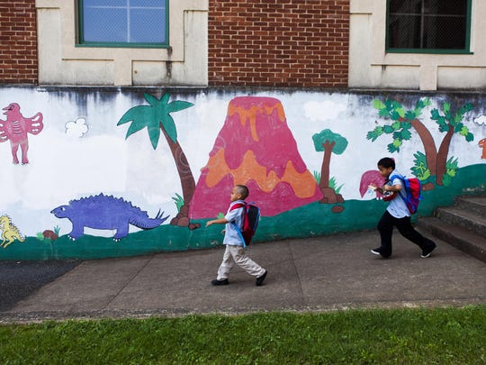 Students at Bass Elementary in Lynchburg walk to their buses at the end of an intersession half-day on Sept. 3, 2015.