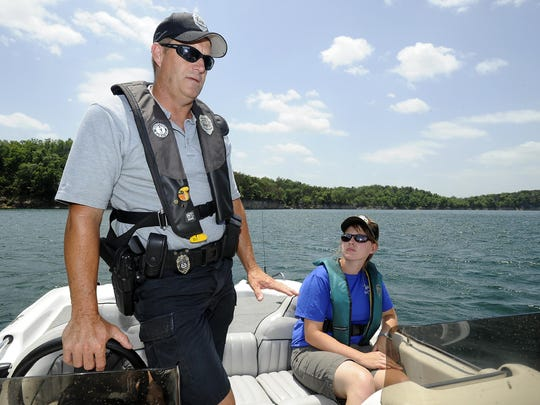 Cpl. Doug Small of the Arkansas Game and Fish Commission talks about boating safety while patrolling Norfork Lake in this file photograph. A new law enacted in Arkansas this summer levies the same penalties for operating a boat while under the influence as a car.
