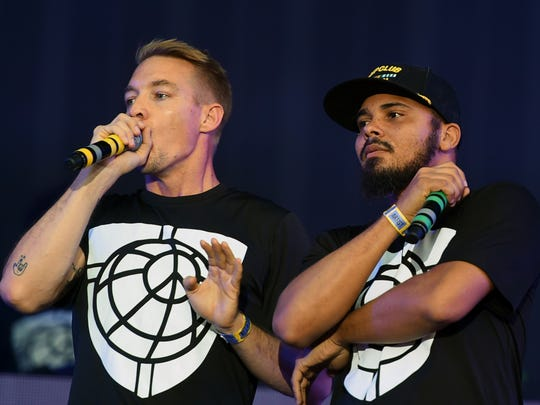 Major Lazer singers Walshy Fire (R) and Diplo (L) perform