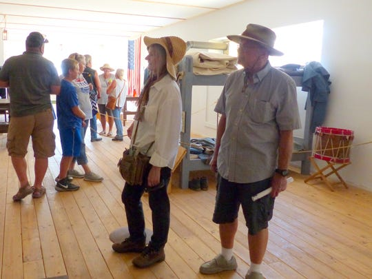 Fort Stanton Live visitors stop in to see a recreation of a solderis barracks.