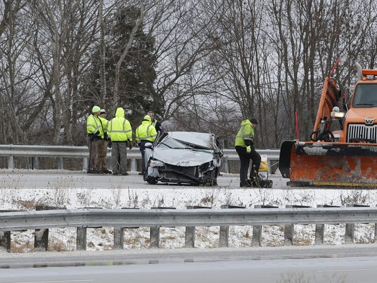 Crews work to clean up a car accident on Interstate