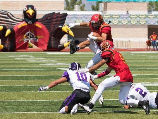 Centennial running back Joaquin Gutierrez leaps over