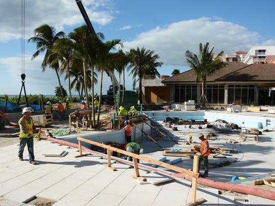 In this file photo from November 2016, construction crews work on the Marco Island Hilton swimming pool. The hotel has been closed since June 1 as it undergoes a $40 million renovation.