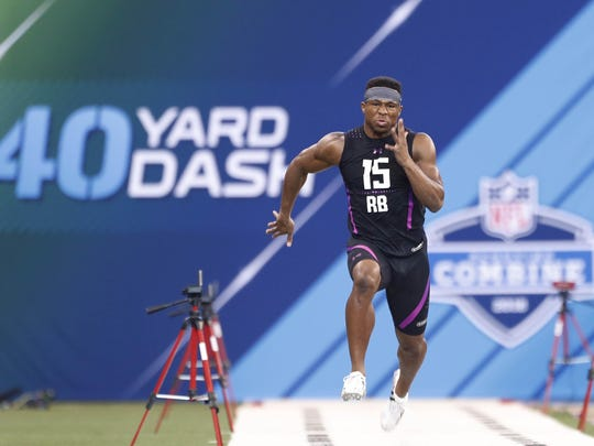 As a North Carolina State running back, Nyheim Hines demonstrated speed at the NFL Combine in Indianapolis.
