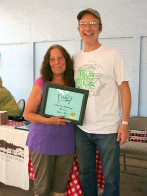 Sue Been poses with Silver City MainStreet Board President Patrick Hoskins after she won the Best Pie Contest on Saturday.