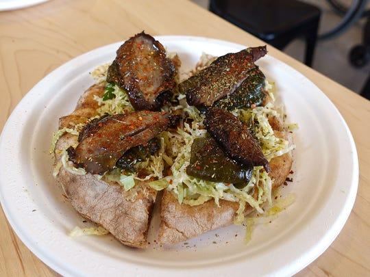 Schiacciata vegetali with roasted poblano peppers and portobello mushrooms, mashed garbanzo beans and aji amarillo at Pa'La.