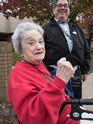 Aspasia Manta makes a fist to show her pleasure at being able to vote for her favorite candidate. She is escorted to the polls by her son, Patrick Manettas. She votes in Westland's 34th precinct, located at the Wayne-Westland Education Center.
