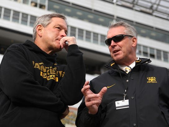 Iowa head football coach Kirk Ferentz, left, and athletic