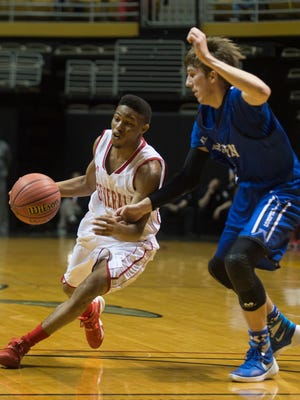 Lee-Montgomery's Kendarius Hartwell drives against Auburn's Christian Brandt during the AHSAA Central Regional semi-final game on Wednesday, Feb. 17, 2016, at the Dunn-Oliver Academe in Montgomery, Ala.