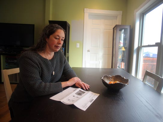 Lisa Buckley of Nyack looks at her Tolls By Mail bill