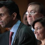 Gov. Bobby Jindal with IBM's Colleen Arnold, right, and CenturyLink's Glen Post, background, announced that IBM will create 400 new jobs in Monroe during the next 10 years. The announcement was made at CenturyLink headquarters in February.