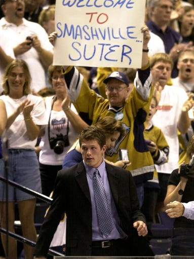 Ryan Suter, a defenseman from Madison, Wis., heads to the stage as he is cheered by Nashville Predator fans after being selected by the Predators in the first round of the NHL draft on June 21, 2003 in Nashville.