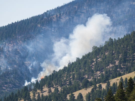 Flames rise from the Lookout Fire near Wolf Creek Sunday.