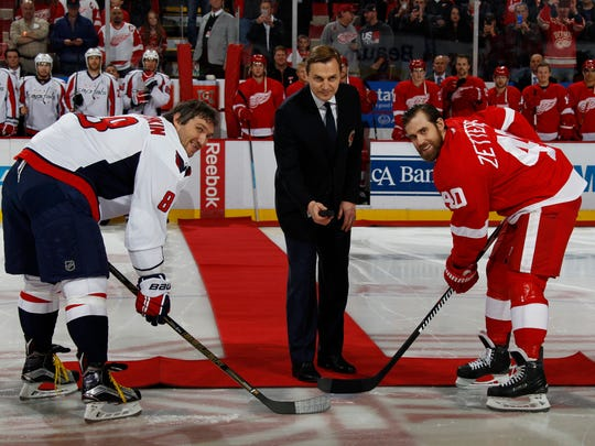 Former Red Wing Sergei Fedorov drops the ceremonial puck between Capitals captain Alex Ovechkin and Red Wings captain Henrik Zetterberg at Joe Louis Arena in November 2015.