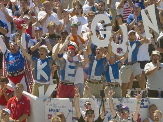 Buffalo Bills fans celebrate as former Bills quarterback Jim Kelly is enshrined into the Pro Football Hall of Fame in Canton, Ohio, on Aug. 3, 2002. (