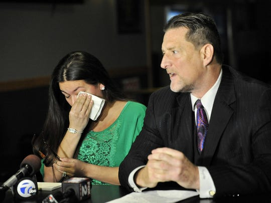 Attorney Greg Rohl holds a press conference Monday with Sandi Jacokes, of Westland, a close family friend of the Kerrs, about the accidental death of Lilliana Kerr.